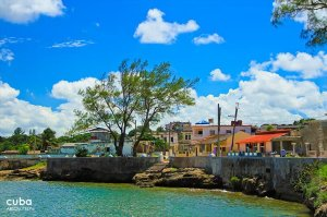 seawall with the city behind in Cojimar © Cuba Absolutely, 2014